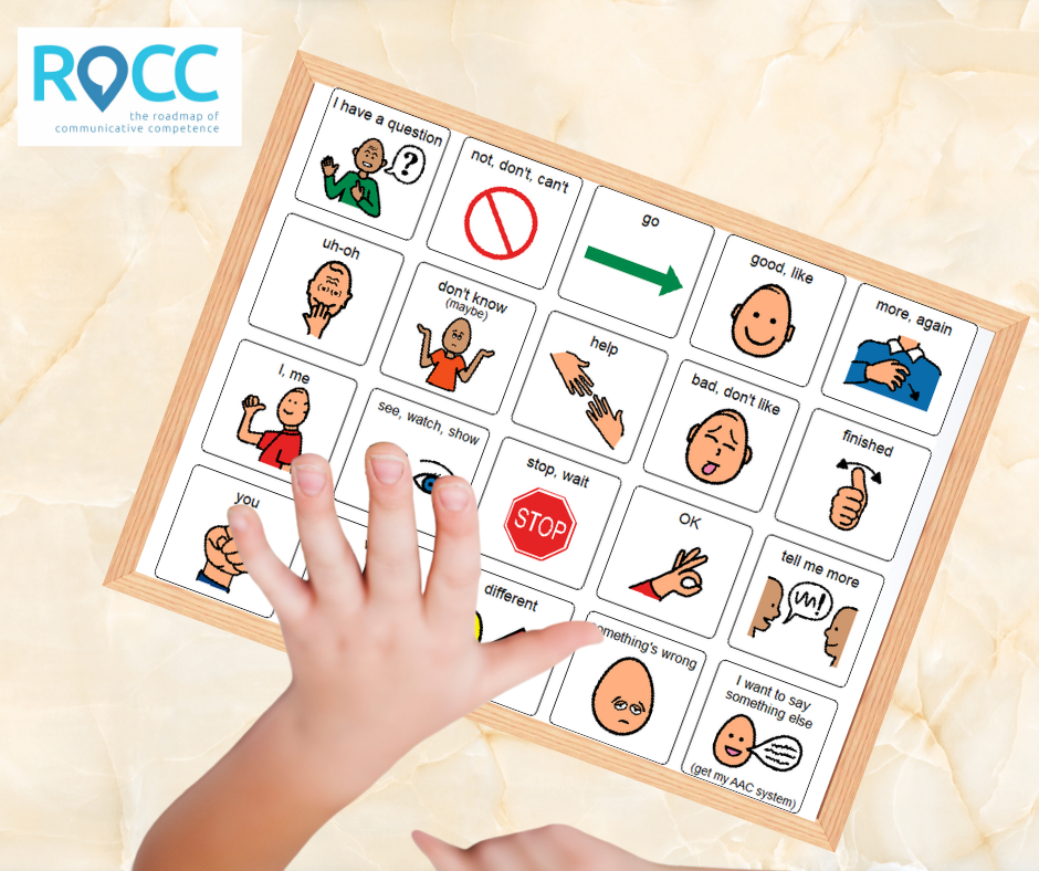 Hand pointing to AAC board